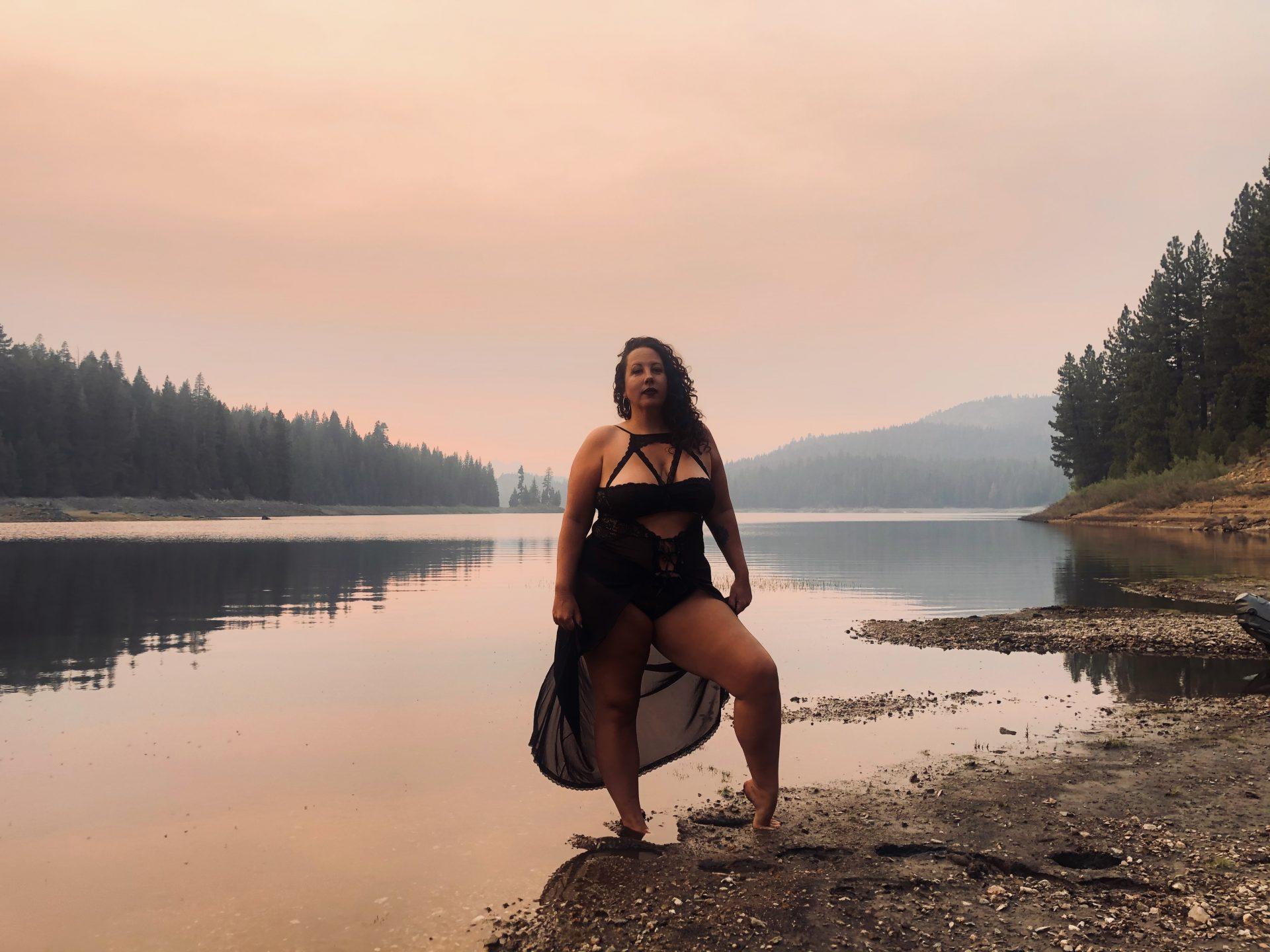 Lalita in Priestess Dress at a mountain top lake